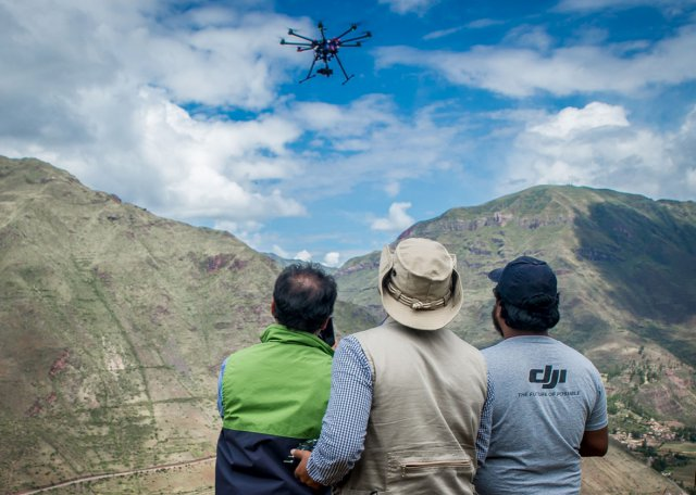 Members of Peru's Ministry of Culture drone team watch a DJI S1000 octocopter in flight at the ruins of Pisaq in the Sacred Valley in April 2015.