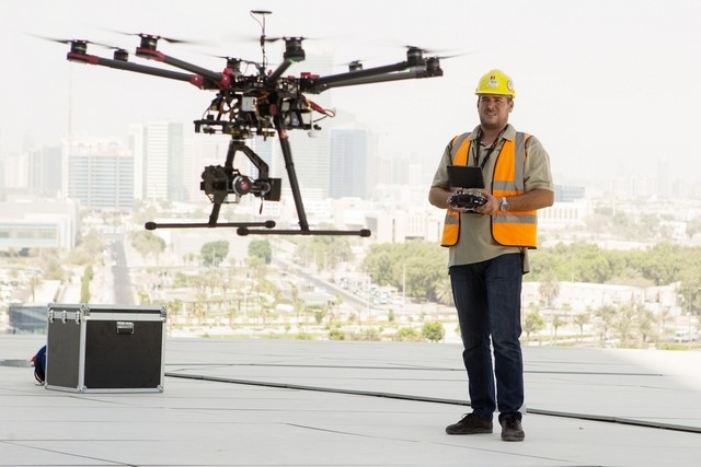 Adriah Ninteoar, the pilot for Technometer Middle East, uses drone technology with an attached thermal camera to inspect and scan the exterior of Etihad Towers in Abu D habi for tiny holes where cold air might escape