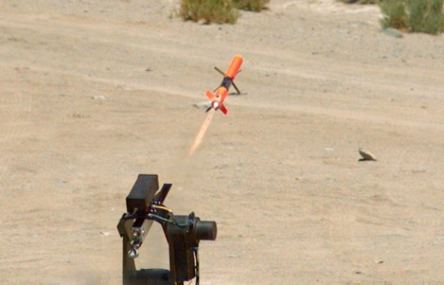 A forward-firing miniature munition - Spike, is launched at an Outlaw, a class-two representative unmanned aerial vehicle (UAV), during a recent and successful counter-UAV demonstration on the land range at Naval Air Warfare Center Weapons Division China Lake - U.S. Navy photo